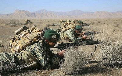 In this photo provided Friday, January 25, 2019, by the Iranian Army, soldiers take position in an infantry drill in the central Isfahan province, Iran. (Iranian Army via AP)