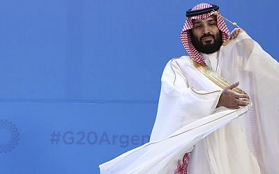 In this photo from November 30, 2018, Saudi Arabia's Crown Prince Mohammed bin Salman adjusts his robe as leaders gather for the group at the G20 Leader's Summit at the Costa Salguero Center in Buenos Aires, Argentina. (AP Photo/Ricardo Mazalan, File)