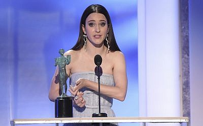 "Rachel Brosnahan accepts the award for outstanding performance by a female actor in a comedy series for ""The Marvelous Mrs. Maisel"" at the 25th annual Screen Actors Guild Awards at the Shrine Auditorium & Expo Hall on Sunday, Jan. 27, 2019, in Los Angeles. (Photo by Richard Shotwell/Invision/AP)"