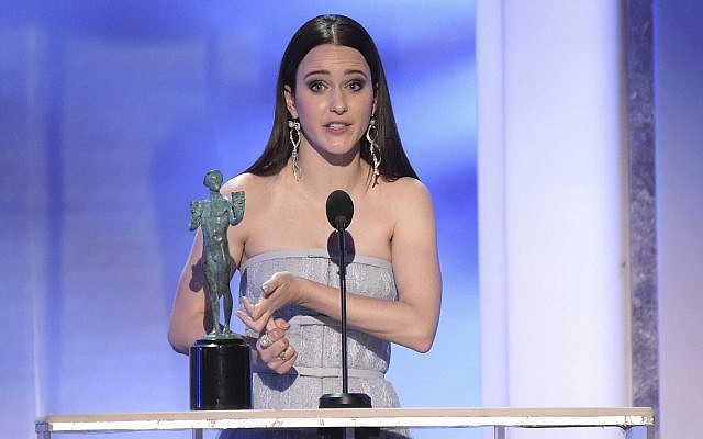 """Rachel Brosnahan accepts the award for outstanding performance by a female actor in a comedy series for """"The Marvelous Mrs. Maisel"""" at the 25th annual Screen Actors Guild Awards at the Shrine Auditorium & Expo Hall on Sunday, Jan. 27, 2019, in Los Angeles. (Photo by Richard Shotwell/Invision/AP)"""