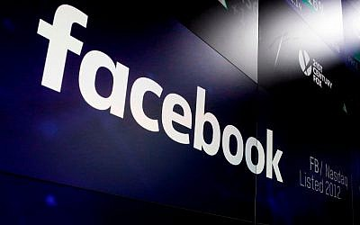 In this March 29, 2018, file photo, Facebook's logo appears on screens at the Nasdaq MarketSite in New York's Times Square. (AP Photo/Richard Drew, File)