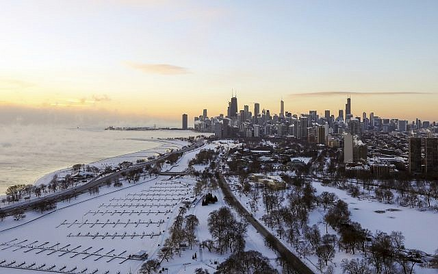 Chicago's lakefront is covered with ice on Wednesday, January 30, 2019, as temperatures plummet and officials warn against venturing out into the dangerously cold weather. (AP Photo/Teresa Crawford)