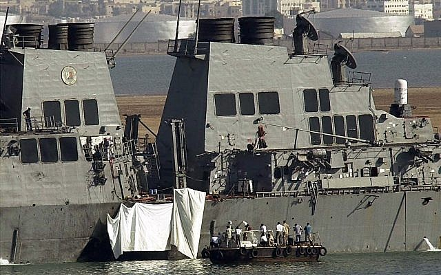 Experts examine the hole on the side of the USS Cole in Aden on October 13, 2000. (AP Photo/Dimitri Messinis)