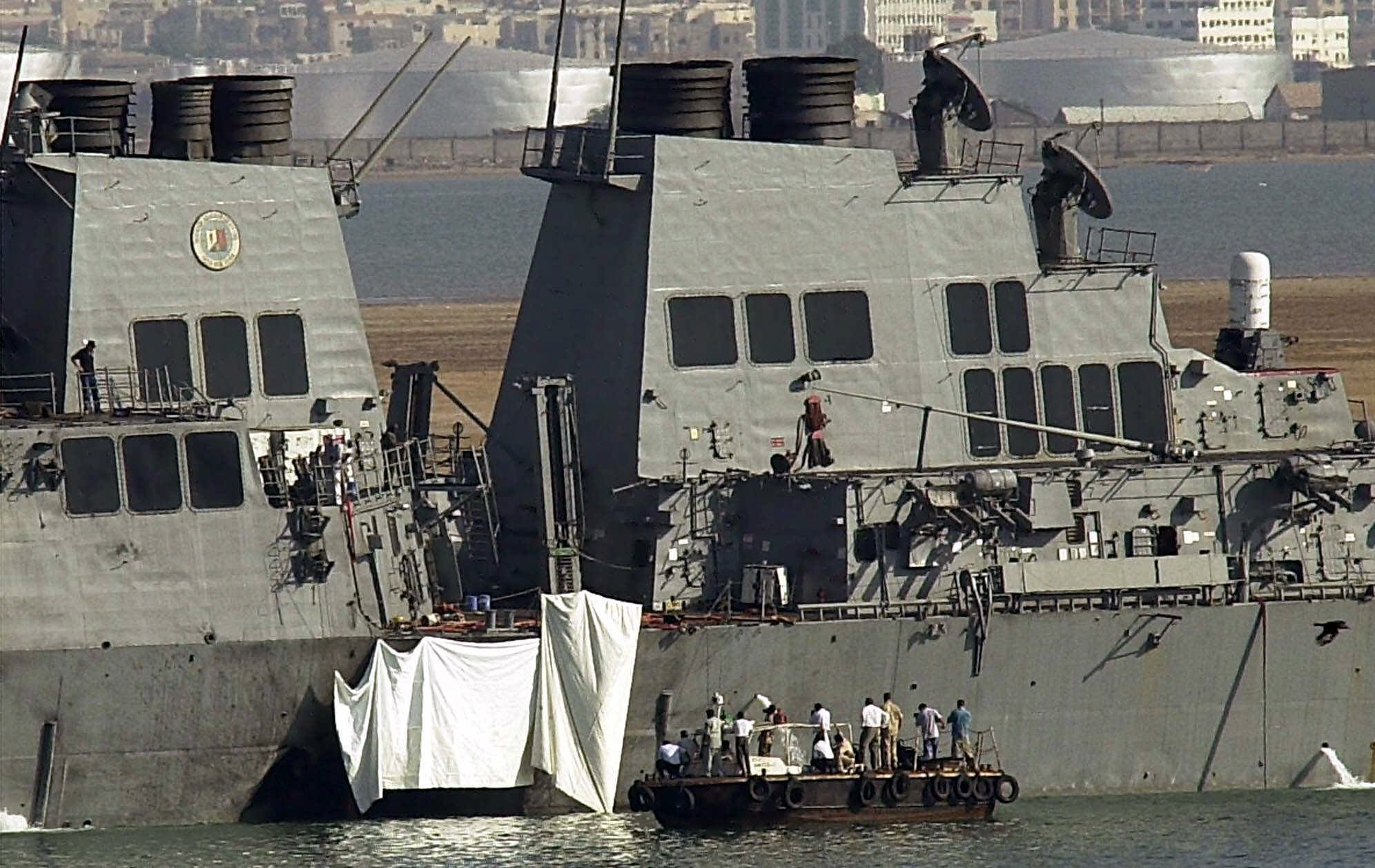 A powerful explosion Thursday ripped a hole in a U.S Navy destroyer in the Yemeni port of Aden killing 17 sailors and injuring some 30 others.(AP