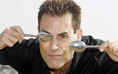Israeli-British illusionist Uri Geller poses during the 24th MIPCOM (International Film and Programme Market for TV, Video,Cable and Satellitte) in Cannes, France, Oct 14, 2008. (AP Photo/Lionel Cironneau)