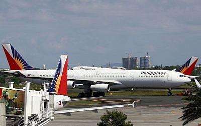 Philippine Airlines passenger planes are parked at the carrier's terminal at the Manila International Airport on April 12, 2012, in Pasay city, south of Manila, Philippines. (AP Photo/Bullit Marquez)