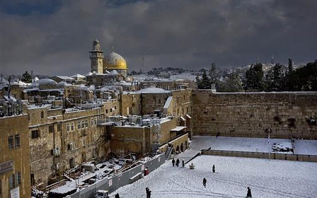 The Western Wall, right, and the gilded Dome of the Rock, among the holiest sites for Jews and Muslims, are covered in snow,  Dec. 13, 2013. (AP Photo/Dusan Vranic)