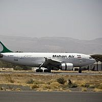 A plane from the Iranian private airline, Mahan Air lands the international airport in Sanaa, Yemen, March 1, 2015. (Hani Mohammed/AP)
