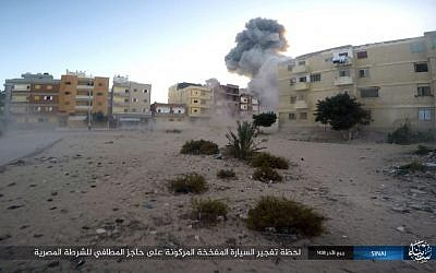 An explosion during an attack on an Egyptian police checkpoint  in el-Arish, north Sinai, Egypt, on January 9, 2017. (Islamic State Group in Sinai/AP)