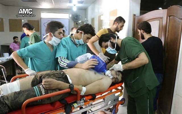 In this Tuesday, Sept. 6, 2016 file photo, provided by the Syrian anti-government activist group Aleppo Media Center (AMC), medical staff treat a man suffering from breathing difficulties inside a hospital in Aleppo, Syria. Washington signaled that it had judged President Bashar Assad responsible for the horrific chemical weapons attack in north Syria that drew international outrage. But it is not the first or even deadliest atrocity of the war. (Aleppo Media Center via AP, File)