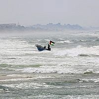 Illustrative: A fisherman navigates rough seas along the coast of the Mediterranean Sea in Gaza City, April 11, 2018. (Adel Hana/AP)