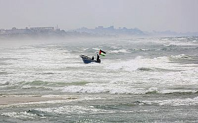 A fisherman navigates rough seas along the coast of the Mediterranean Sea in Gaza City, April 11, 2018. (Adel Hana/AP)