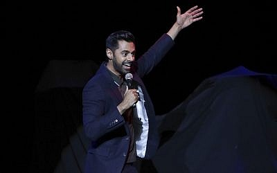 Comedian Hasan Minhaj performs on stage during the 11th Annual Stand Up for Heroes benefit on Tuesday, Nov. 7, 2017, in New York. ( Brent N. Clarke/Invision/AP)