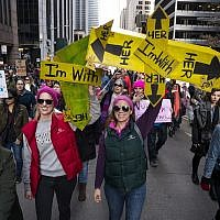 People take part in a march highlighting equal rights and equality for women walk along Sixth Avenue, Saturday, Jan. 20, 2018, in New York. On the anniversary of President Donald Trump's inauguration, people participating in rallies and marches in the U.S. and around the world Saturday denounced his views on immigration, abortion, LGBT rights, women's rights and more. (AP Photo/Craig Ruttle)