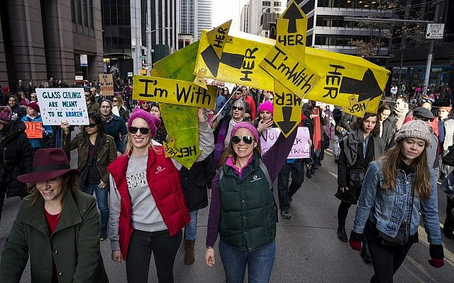 People take part in a march highlighting equal rights and equality for women walk along Sixth Avenue, Saturday, January 20, 2018, in New York. (AP Photo/Craig Ruttle)