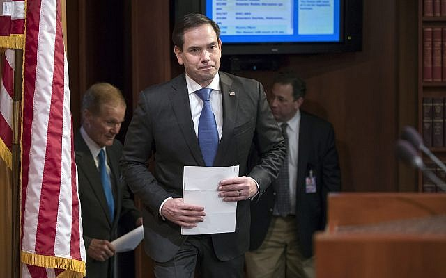 Sen. Marco Rubio (Republican- Florida), center, arrives for a news conference at the Capitol in Washington, March 7, 2018. (J. Scott Applewhite/AP)