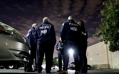 Illustrative photo of US Immigration and Customs Enforcement agents in Los Angeles,  January 10, 2018. (Chris Carlson/AP)