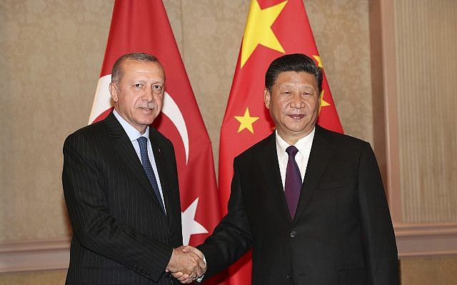 Turkey's President Recep Tayyip Erdogan, left, and China's President Xi Jinping shake hands prior to their meeting in Johannesburg, South Africa, July 26, 2018 (Presidential Press Service via AP, Pool)