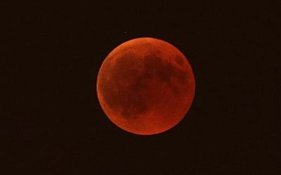 A blood moon rises over Marseille, southern France, Friday, July 27, 2018. (AP Photo/Claude Paris)