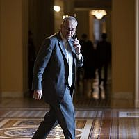 Senate Minority Leader Chuck Schumer, D-N.Y., makes a phone call just off the Senate floor on Capitol Hill in Washington, Wednesday, Aug. 1, 2018. (AP Photo/J. Scott Applewhite)