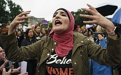 Linda Sarsour with Women's March calls out to other activists opposed to President Donald Trump's embattled Supreme Court nominee, Brett Kavanaugh, in front of the Supreme Court in Washington, Monday, Sept. 24, 2018.(AP Photo/Carolyn Kaster)