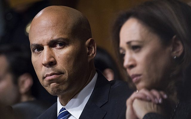 US Sen. Cory Booker, D-N.J., and Sen. Kamala Harris, D-Calif., listen as Dr. Christine Blasey Ford testifies during the Senate Judiciary Committee on September 27, 2018. (Tom Williams/Pool Photo via AP)