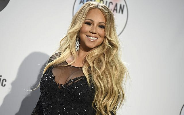 Mariah Carey poses in the press room at the American Music Awards on October 9, 2018, at the Microsoft Theater in Los Angeles. (Jordan Strauss/Invision/AP)