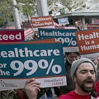 In the April 26, 2017 photo, supporters of single-payer health care march to the Capitol in Sacramento, Calif. (AP Photo/Rich Pedroncelli)