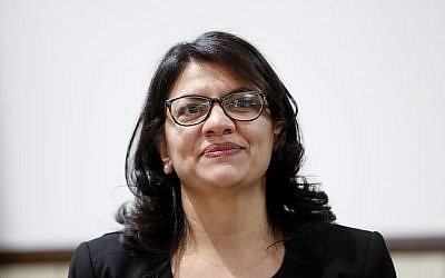 Rashida Tlaib, US Democratic Rep. for Michigan's 13th congressional district, listens during a rally in Dearborn, Michigan, October 26, 2018. (AP Photo/Paul Sancya)