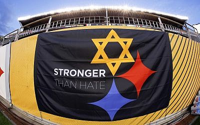 """A """"Stronger Than Hate"""" banner is displayed on the sidelines before an NFL Football game between the Pittsburgh Steelers and the Carolina Panthers, Thursday, November 8, 2018, at Heinz Field in Pittsburgh. (AP/Gene J. Puskar)"""