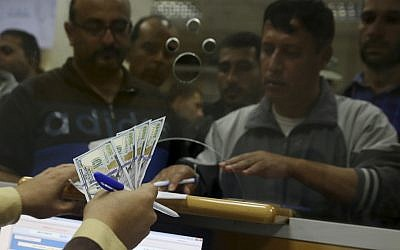 Hamas government employees wait to receive 60 percent of their long-overdue salaries, at the main Gaza Post Office, in Gaza City, November 9, 2018. (AP Photo/Adel Hana)