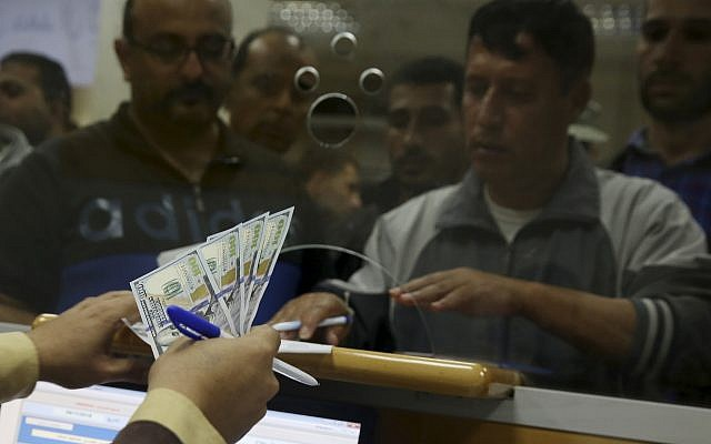 Hamas government employees wait to receive 60 percent of their long-overdue salary, at the main Gaza Post Office, in Gaza City, November 9, 2018. (AP Photo/Adel Hana)