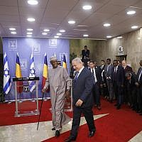 Prime Minister Benjamin Netanyahu, right, and President of Chad Idriss Deby leave after giving a joint press conference, in Jerusalem, Sunday, Nov. 25, 2018. (Ronen Zvulun/Pool via AP)