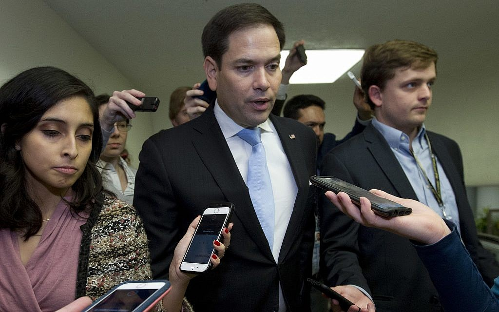 Sen. Marco Rubio, R-Fla., speaks with reporters on his way to the senate chamber, as the Senate takes up a House-passed bill that would pay for President Donald Trump's border wall and avert a partial government shutdown, at the Capitol in Washington, Friday, Dec. 21, 2018. (AP Photo/Jose Luis Magana)