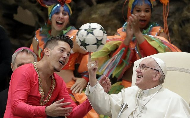 Pope Francis twirls a soccer ball he was presented by a member of the Circus of Cuba, during his weekly general audience in the Pope Paul VI hall, at the Vatican, Wednesday, Jan. 2, 2019. (AP/Andrew Medichini)