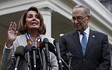 House Speaker Nancy Pelosi of California, left, and Senate Minority Leader Chuck Schumer speak to the media after meeting with US President Donald Trump on January 2, 2019. (AP Photo/Jacquelyn Martin)