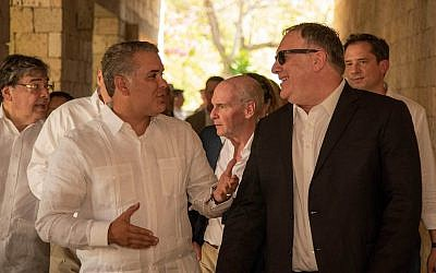 US Secretary of State Mike Pompeo, right, and Colombia's President Ivan Duque talk during a meeting at the Presidential Guest House in Cartagena, Colombia, Wednesday, Jan. 2, 2019. (Nicolas Galeano/Colombia's Presidency via AP)