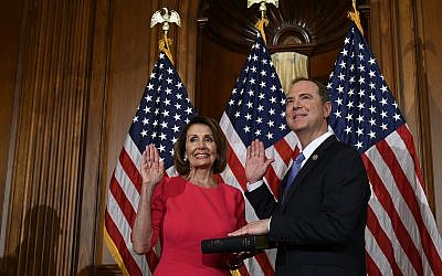 House Speaker Nancy Pelosi (L), poses during a ceremonial swearing-in with Rep. Adam Schiff, (Democrat-California) right, on Capitol Hill in Washington, Thursday, Jan. 3, 2019, during the opening session of the 116th Congress. (AP Photo/Susan Walsh)