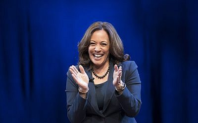 Kicking off her book tour, Sen. Kamala Harris, D-Calif., greets the audience at George Washington University in Washington, Wednesday, Jan. 9, 2019. Harris describes herself as a 'progressive prosecutor' in her memoir. (AP Photo/Sait Serkan Gurbuz)