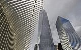 Parts of the Oculus, left, One World Trade Center, center, and 7 World Trade Center are seen from street level, Jan. 9, 2019, in New York. (AP Photo/Kathy Willens)