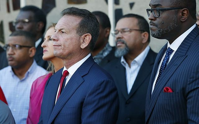 Suspended Broward County Sheriff Scott Israel, center, at a news conference after new Florida Gov. Ron DeSantis suspended Israel on January 11, 2019, in Fort Lauderdale, Florida. (AP Photo/Wilfredo Lee)