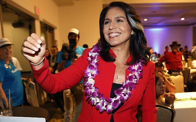 In this Nov. 6, 2018, file photo, Rep. Tulsi Gabbard, D-Hawaii, greets supporters in Honolulu (AP Photo/Marco Garcia, File)