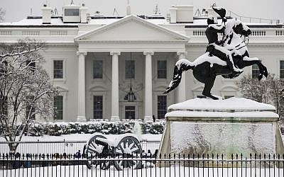 A snow covered White House White House on Sunday, Jan. 13, 2019, in Washington. (AP Photo/Alex Brandon)