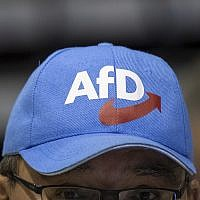 A participant in a European election meeting of the Alternative for Germany party, AfD, wears a cap with the party's logo in the Saxony-Arena in Riesa, Germany, January 13, 2019. (Monika Skolimowska/dpa via AP, file)