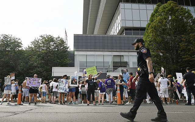 Family and friends who have lost loved ones to OxyContin and opioid overdoses protest outside Purdue Pharma headquarters in Stamford, Connecticut, August 17, 2018. (Jessica Hill/AP)