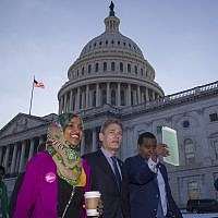 Rep. Ilhan Omar, D-Minn., left, Rep. Tom Malinowski, D-N.J., Rep. Joe Neguse, D-Colo., and other freshmen members of the House of Representatives walk to the Senate side to speak about the government shutdown on Capitol Hill, Tuesday, Jan. 15, 2019 in Washington. (AP Photo/Alex Brandon)