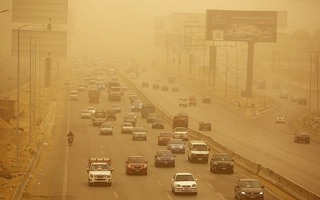 Vehicles drive during a sandstorm in Cairo, Egypt, Wednesday, Jan. 16, 2019. (AP Photo/Amr Nabil)