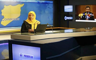 This undated photo provided by Iranian state television's English-language service, Press TV, shows American-born news anchor Marzieh Hashemi at studio in Tehran, Iran. (Press TV via AP)