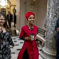 Rep. Ilhan Omar, D-Minn., center, walks through the halls of the Capitol Building in Washington, Wednesday, Jan. 16, 2019. (AP/Andrew Harnik)