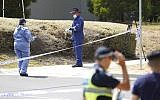 Police investigators work at the scene Wednesday, Jan. 16, 2019 where the body of Israeli student student Aiia Maasarwe was found in Melbourne, Australia. Australian police are looking for at least one attacker who killed the Israeli woman as she was walking on a city street speaking to her sister by phone. (Stefan Postles/AAP Image via AP)